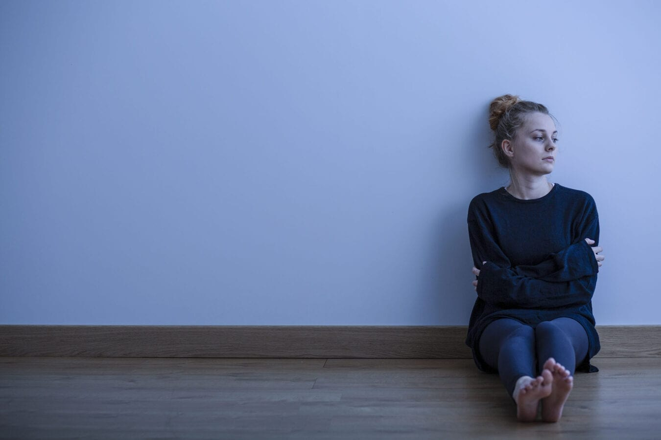 Picture of a sad teenage girl suffering from loneliness, sitting