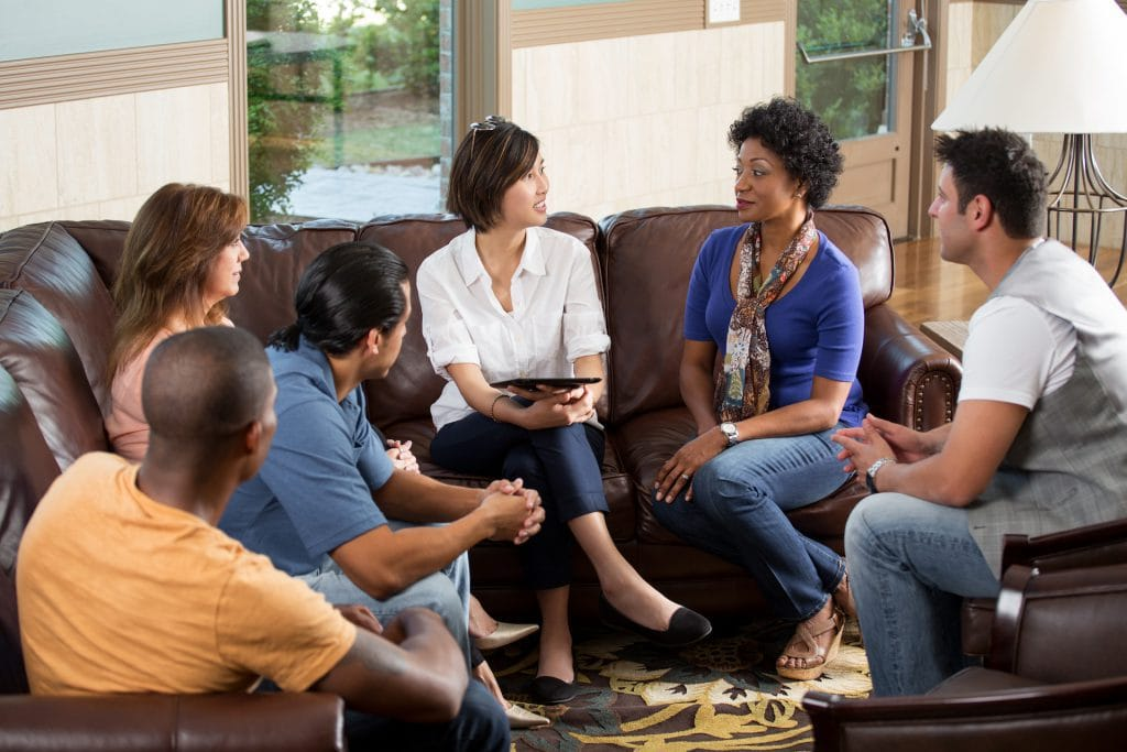 Group of people siting on brown couch