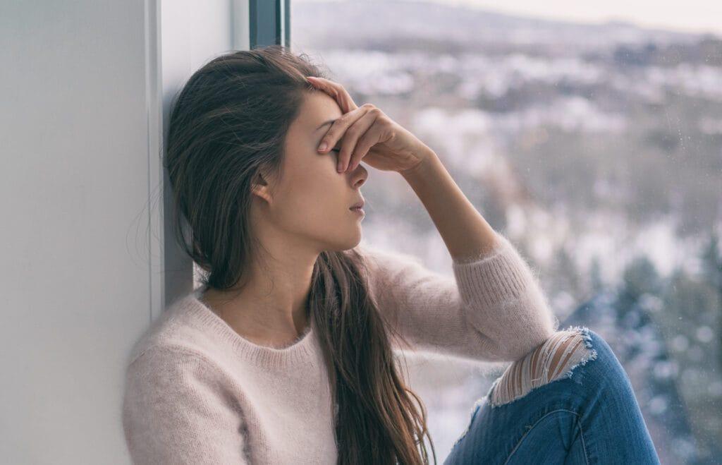 Sad woman with had over head