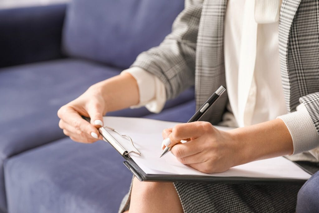 Female psychologist with clipboard in office, closeup