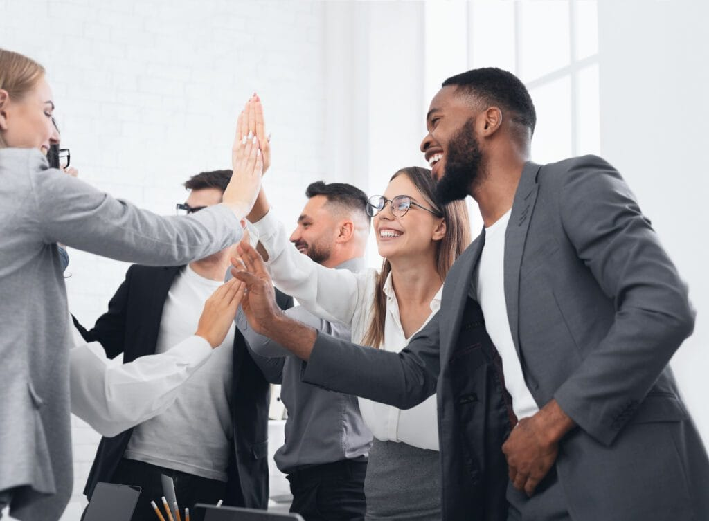 Business team giving group high five, celebrating