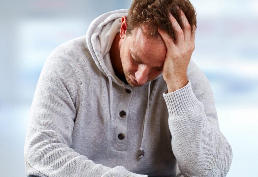 Depressed man having a headache
